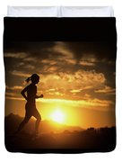A Woman Jogs Under Sunset Duvet Cover