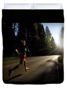 A Woman Running On A Country Road Duvet Cover