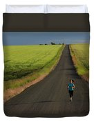 A Woman Running On A Dirt Road Duvet Cover