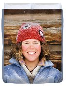 A Woman Stands Against A Log Cabin Duvet Cover