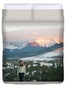 A Woman Stands Against A Snowy Mountain Duvet Cover