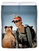 A Woman  Talks To Her Dog While Taking Duvet Cover