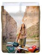 A Woman Unloads Gear From Her Canoe Duvet Cover