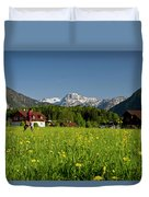 A Woman Walks Through An Alpine Meadow Duvet Cover