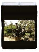 A Wooden Sculpture Inside A Garden Duvet Cover