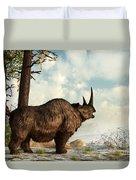A Woolly Rhinoceros Trudges Duvet Cover by Daniel Eskridge