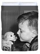 A Young Boy Is Face To Face With A Puppy Tongue. Duvet Cover