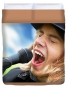 A Young Man Sings To A Microphone Duvet Cover