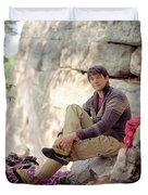 A Young Rock Climber Puts On A Climbing Duvet Cover