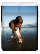 A Young Woman Collects Seashells Duvet Cover