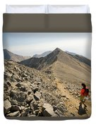 A Young Woman Hikes Borah Peak Duvet Cover