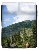 Adult Woman Hiking Through An Alpine Duvet Cover