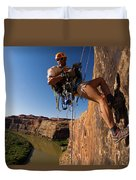 Adventure Racer Rappelling Over A River Duvet Cover