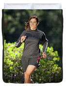 An Athletic Woman Trail Running Duvet Cover