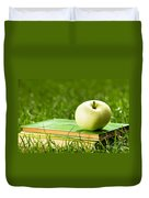 Apple On Pile Of Books On Grass Duvet Cover
