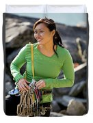 Attractive Female Climber Adjusting Duvet Cover