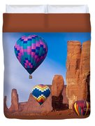 Balloon Festival In Monument Valley Duvet Cover