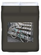 Bicycle Is Chained To A Fence Duvet Cover