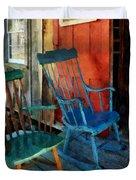 Blue Chair Against Red Door Duvet Cover