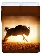 Blue Wildebeest Running In Dust Duvet Cover by Johan Swanepoel