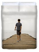 Boy Walking On Concrete Beach Pier Duvet Cover