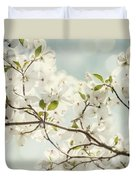 Bright White Dogwood Flowers Against A Pastel Blue Sky With Dreamy Bokeh Duvet Cover