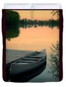 Canoe At A Dock At Sunset Duvet Cover by Jill Battaglia