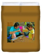 Child Watches As Mom Works In Teak Wood Carving Shop In Kanchanaburi-thailand Duvet Cover