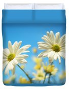 Close-up Of Daisies Against A Blue Duvet Cover