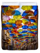 Colorful Floating Umbrellas Duvet Cover by Marco Oliveira