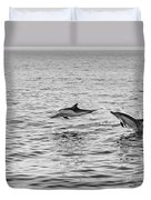 Common Dolphins Leaping. Duvet Cover