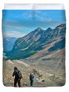 Couple Hiking On Plain Of Six Glaciers Trail  In Banff Np-albert Duvet Cover