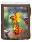 Couple Holding Autumn Leaves Duvet Cover