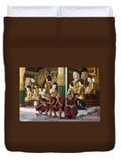 faithful Buddhist monks siiting around Buddha Statues in SHWEDAGON PAGODA Duvet Cover