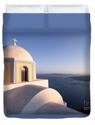 Famous Orthodox Church In Santorini Greece At Sunset Duvet Cover by Matteo Colombo