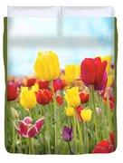 Field Of Tulip Flowers Against Blue Sky Duvet Cover