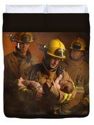 Fire Fighters Rescuing A Baby Duvet Cover by Don Hammond