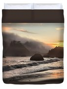 Fire Over The Sea Stacks Duvet Cover by Adam Jewell
