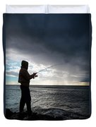 Fisherman Fishing While Storm Blows Duvet Cover
