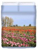 Flowers Blooming In Tulip Field In Springtime Duvet Cover