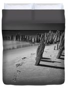 Footprints In The Sand Among The Pilings Duvet Cover