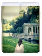 Lady Sitting On A Hill Above A Lake Duvet Cover