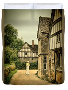 Lady Walking In The Village Duvet Cover