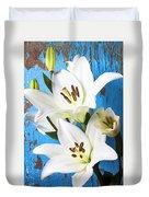 Lilies Against Blue Wall Duvet Cover