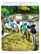 Line Of Bicycles In Park Duvet Cover