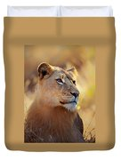 Lioness Portrait Lying In Grass Duvet Cover