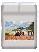 Maasai Men Sitting. Savannah Landscape In Tanzania Duvet Cover