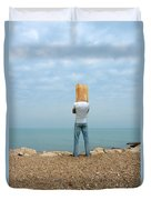 Man By The Sea With Bag On His Head Duvet Cover