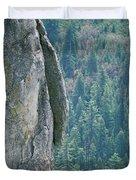 Man Climbing On A Big Granite Spire Duvet Cover