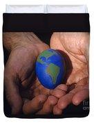 Man Holding Earth Egg Duvet Cover by Jim Corwin